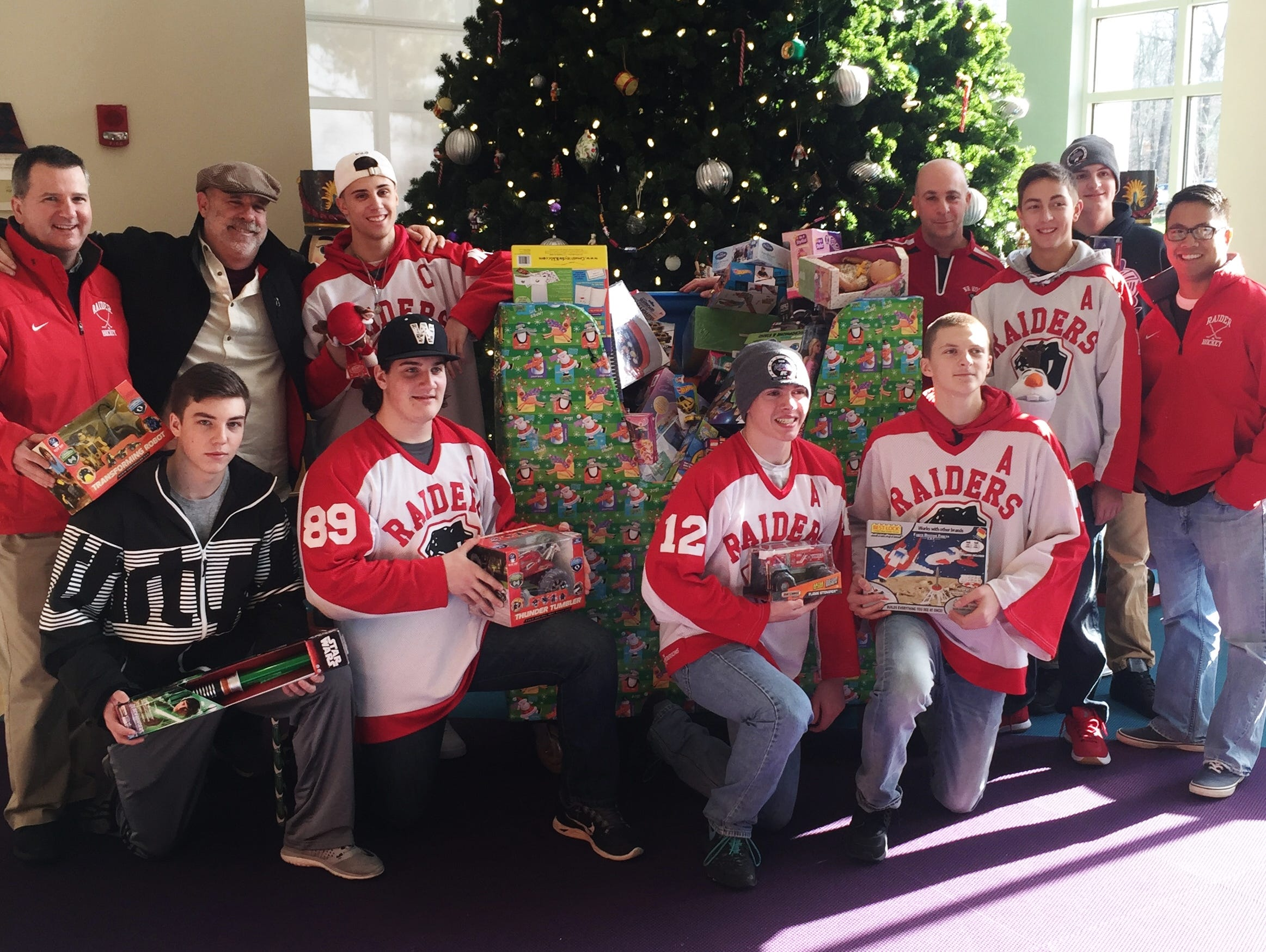 The coaches and captains from North Rockland and Monroe-Woodbury donate toys to the Maria Fareri Children's Hospital.