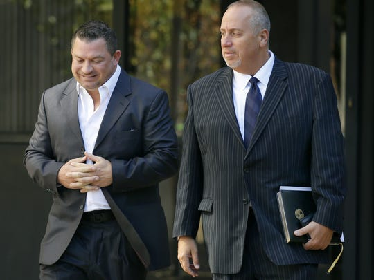 5LINX Enterprises partner Jason Guck and attorney Joseph Damelio leave the Federal Building after an arraignment in October.