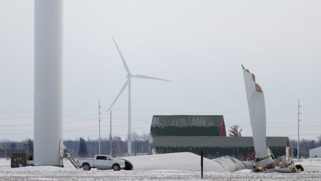 In this photo taken on Thursday, Feb. 25, 2016, an Exelon Corp. wind turbine lies on the ground in Oliver Township just northeast of Pigeon in Huron County, Mich. It fell over during a winter storm that brought wind and heavy snow to much of the state, but the cause of the collapse is unclear. (Jeff Schrier/The Saginaw News via AP) ALL LOCAL TELEVISION OUT; LOCAL TELEVISION INTERNET OUT; MANDATORY CREDIT