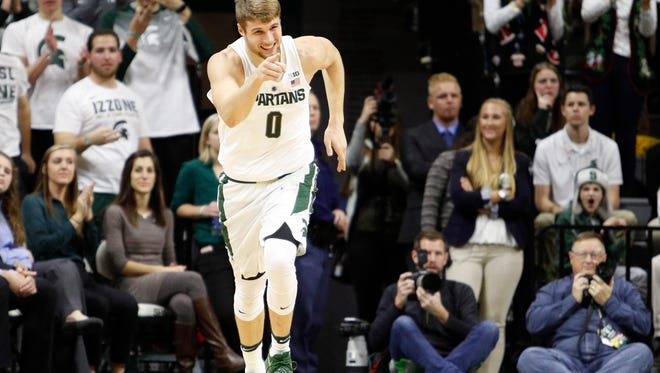 Michigan State sophomore Kyle Ahrens celebrates after making a basket during the first half against Tennessee Tech. Ahrens, playing out of position at power forward, tallied nine points and seven rebounds in 27 minutes.