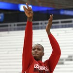 U of L's Terry Rozier, #0, shoots during practice ahead of playing NC State in the Sweet 16 Tournament in Syracuse, NY. March 26, 2015