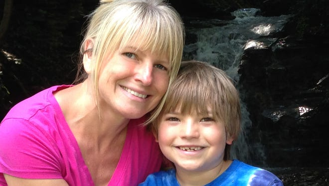 Micheline DeFranco, of Brighton, became a patient of the Mary M. Gooley Hemophilia Center while pregnant with her son Christian, now 8. The two are pictured here.