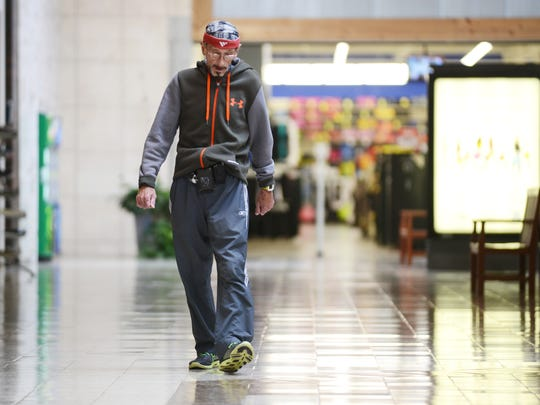 Boyd Otero walks at the Colony Square Mall on Tuesday. Ortero is nearing his goal of walking 24,901 miles at the mall, the distance around the earth. He expects to reach his goal on Friday during a party in his honor.