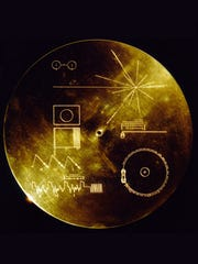 A photo of a Golden Record, which is attached to both