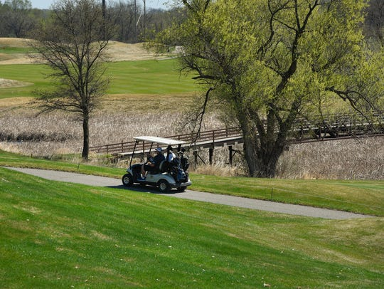 Golfers play Territory Golf Club, shown Monday, May