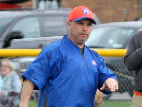 Zack Brown coaches the Edison baseball team last year against Elmira Notre Dame. Brown will be unable to coach the Spartans this season.