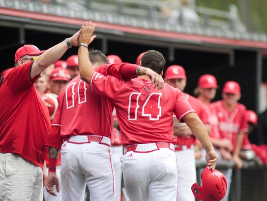 UL's  Kennon Fontenot (14) is congratulated by teammates