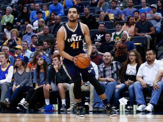 Utah Jazz forward Trey Lyles (41) controls the ball in the second quarter against the Denver Nuggets at the Pepsi Center.