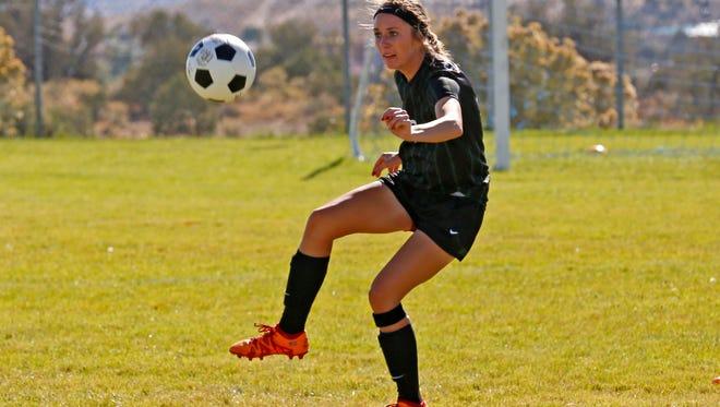 Farmington's Hannah Kelley turns the ball around during a game against Piedra Vista on Oct. 8 at the PV soccer fields in Farmington.