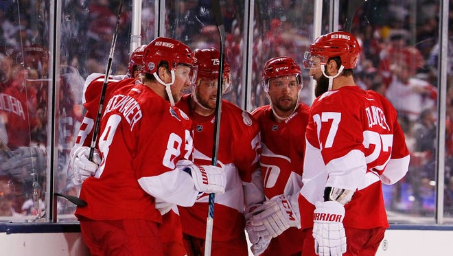 Red Wings left wing Justin Abdelkader (8) celebrates with teammates after scoring a goal against the Avalanche in the third period of the Wings' 5-3 win Saturday at Coors Field.