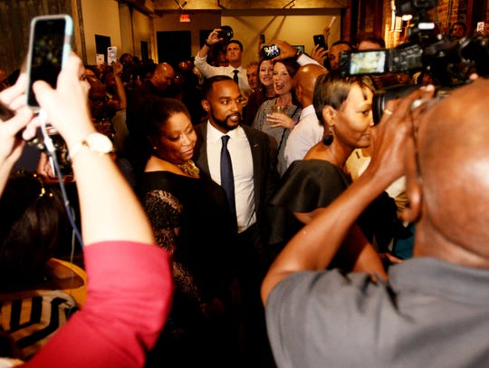 Adrian Perkins talks to supporters during the election