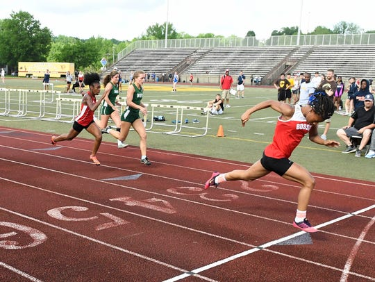 Bosse's Tionne Brigham crosses the finish line to win