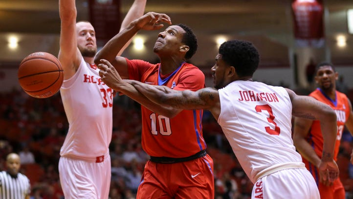 Houston Cougars guard Ronnie Johnson (3) is called