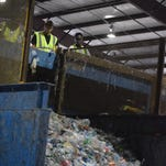 An employee hauls cardboard to be recycled at FV Recycling in Sumrall.