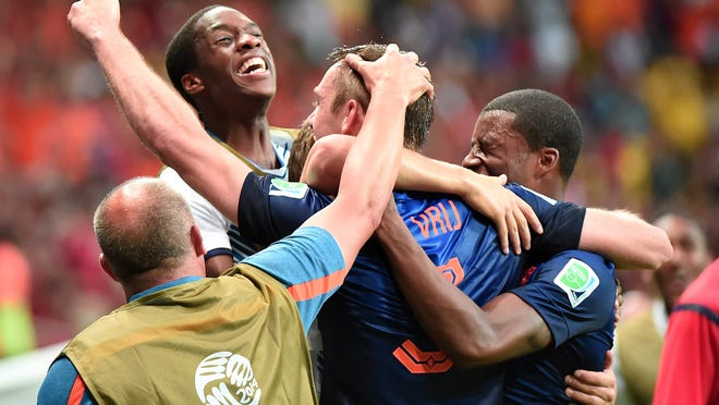 Netherlands defender Stefan de Vrij (center) celebrates scoring his team's third goal with teammates during Friday's 5-1 World Cup victory over Spain in Salvador, Brazil.