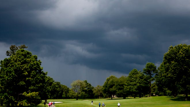Dark storm clouds begin to roll over the event during the News Sentinel Open at Fox Den Country Club in Knoxville, Tennessee on Thursday, August 17, 2017.