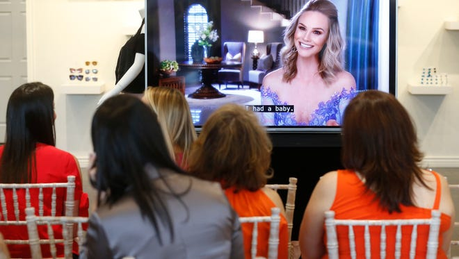 """Gal Fashion customers mingle before the season premiere of """"The Real Housewives of Orange County,"""" starring Meghan King Edmonds, who wears clothes from the El Paso store. The West Side store showed the episode."""