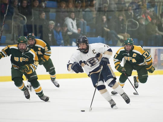 Essex's Ryan Young (7) skates down the ice with the puck during a game last season.