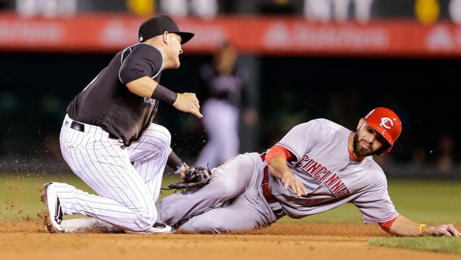 Jul 5, 2017; Denver, CO, USA; Colorado Rockies shortstop Pat Valaika (4) tags out Cincinnati Reds second baseman Jose Peraza (9) in the eighth inning at Coors Field. Mandatory Credit: Isaiah J. Downing-USA TODAY Sports