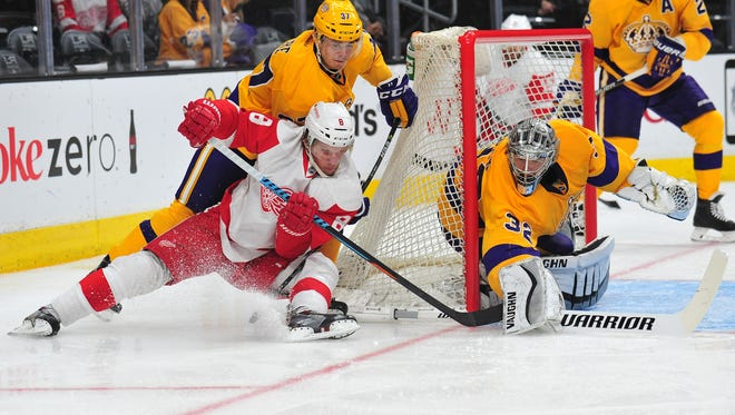 Detroit Red Wings left wing Justin Abdelkader (8) moves in for a shot on goal against  Los Angeles Kings center Nick Shore (37) and goalie Jonathan Quick (32) during the second period at Staples Center.