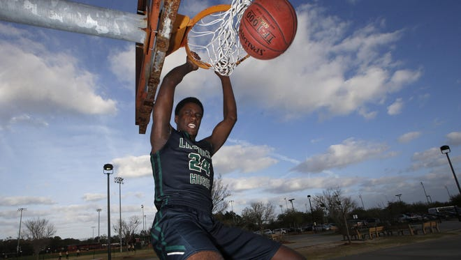 Lincoln senior center Dwight Wilson was the All-Big Bend Defensive Player of the Year last year. Wilson, a James Madison signee, has been charged with leading the Trojans back to the state final four.