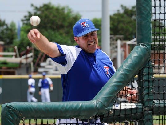 Louisiana Tech coach Greg Goff throws batting practice