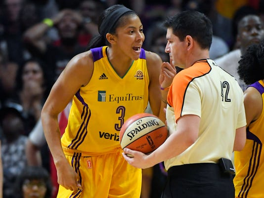 Los Angeles Sparks forward Candace Parker, left, complains about a call to referee Roy Gulbeyan during the second half in Game 4 of the WNBA Finals against the Minnesota Lynx, Sunday, Oct. 16, 2016, in Los Angeles. The Lynx won 85-79. (AP Photo/Mark J. Terrill)