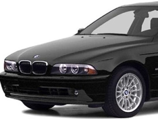 """Police released this photo as an example of the type of vehicle linked to Phoenix's """"serial street shooter."""" Investigators say they believe the shooter has access to multiple vehicles, including a white Cadillac or Lincoln-type car and a black, late '90s or early 2000s 5 Series BMW."""