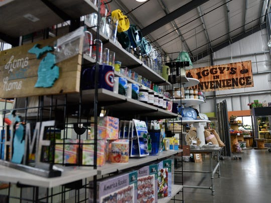 Coffee mugs, decorations and other trinkets sit for sale at the Lansing City Market  Thursday, Aug. 25, 2016 by the Iggy's In Convenience stand. The loss of actual farmers at the market has led the market to drop the acceptance of food assistance programs.