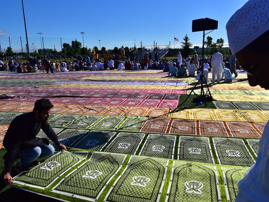Prayer rugs are set up for Eid al-Fitr prayers marking the end of the holy month of Ramadan at Overpeck County Park in Ridgefield Park on Friday.