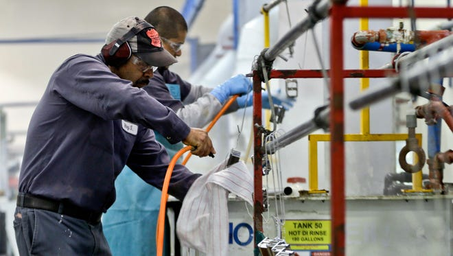 Employees work on the factory floor in San Diego on Oct. 10, 2013.