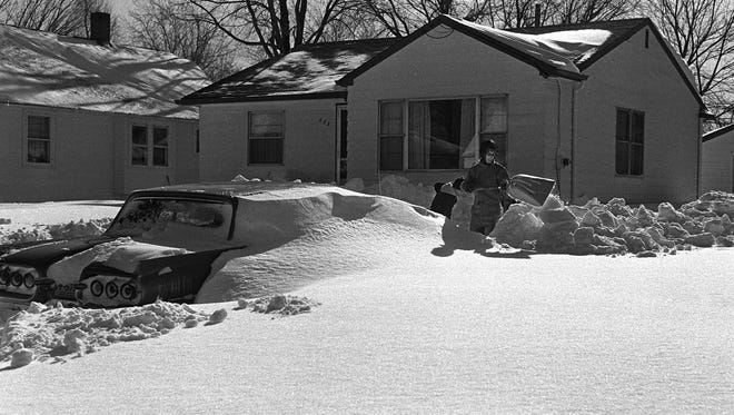 Lansing residents dig out after the record snowfall in January of '67.