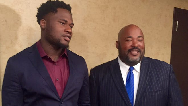 Tennessee State defensive end Ebo Ebenezer, who was named to the Preseason All-OVC team Monday, with Tigers coach Rod Reed at football media day Holiday Inn Nashville on West End.