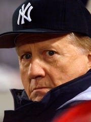 New York Yankees owner George Steinbrenner watches his team play in Atlanta on Oct. 23, 1999.