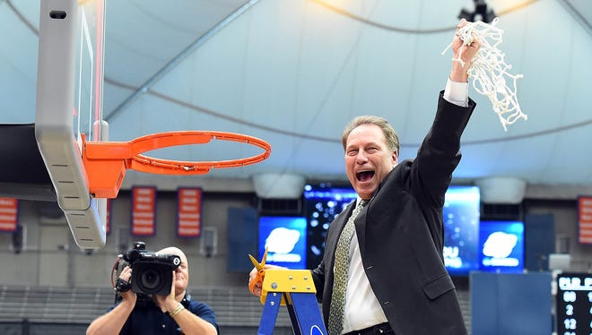 Mar 29, 2015; Syracuse, NY, USA; Michigan State Spartans head coach Tom Izzo cuts down the net after the game against the Louisville Cardinals in the finals of the east regional of the 2015 NCAA Tournament at Carrier Dome. The Michigan State Spartans won 76-70.