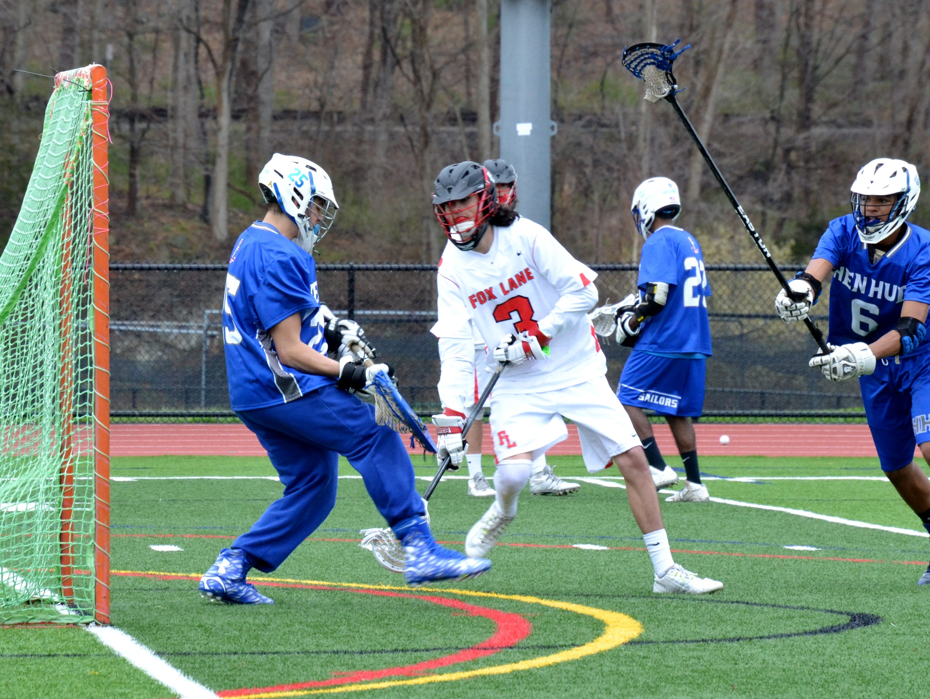 Fox Lane attackman Ryder Beitzel goes low and scores in the second half of the Foxes' 17-7 win over Hen Hud on Saturday.