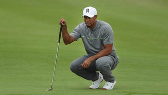 Tiger Woods lines up his putt on the first green during Round 3 of the Hero World Challenge.