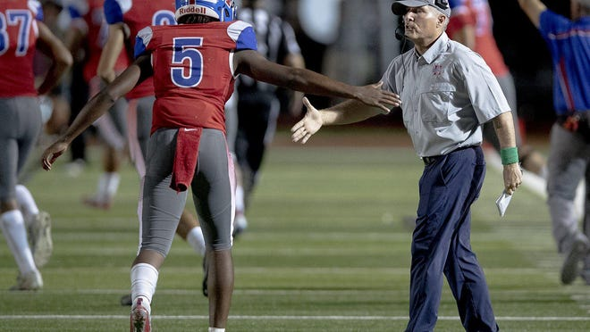 Hays head coach Les Goad led the Rebels to a 35-7 win over San Marcos Friday.