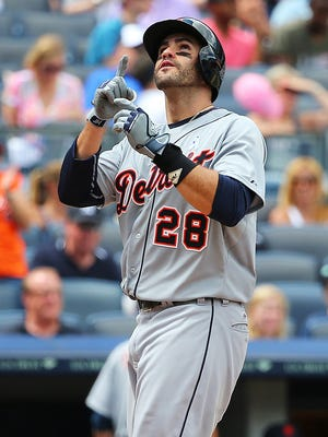 J.D. Martinez crosses home after the third of three homers Sunday against the Yankees.
