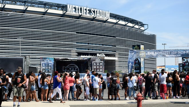 Concert goers wait in line outside of MetLife Stadium for an outdoor stage before Hot 97's Summer Jam begins in East Rutherford, NJ on Sunday, June 11, 2017.