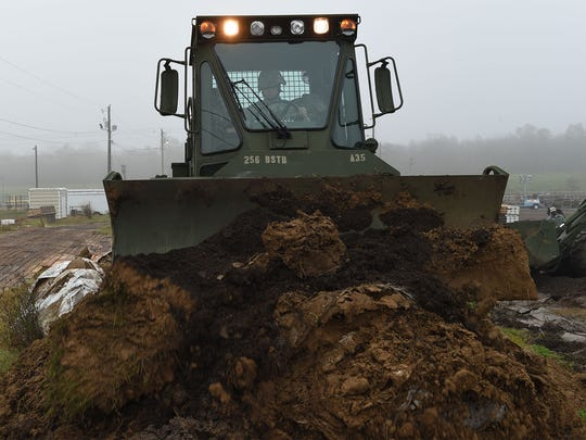 Louisiana National Guard Pvt. Taner Mansur of Walker La., assigned to the 769th Brigade Engineer Battalion, 256th Infantry Brigade Combat Team, drivers a M105 Deployable Universal Combat Earthmover to repair a levee in Krotz Springs, La., in advance of expected river flooding, Jan. 8, 2016. The Louisiana National Guard has now mobilized more than 250 personnel in an effort to build protective barriers against the approaching flood waters and to patrol levees in support of local, parish and state officials at the request of the Governor's Office of Homeland Security and Emergency Preparedness.