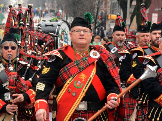 York's St. Patrick's Day features drums and bagpipes.
