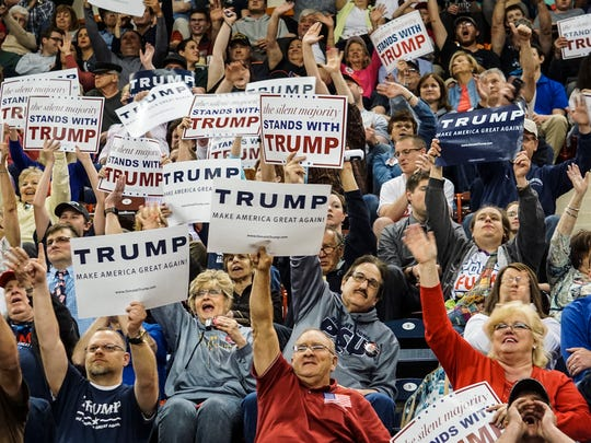 The audience cheers for Republican presidential candidate Donald Trump during his rally at the Pennsylvania Farm Show Complex in Harrisburg on April 21, 2016.
