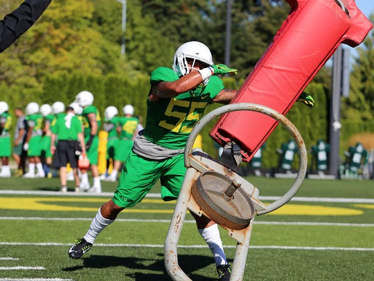 Oregon linebacker A.J. Hotchkins competes during practice.