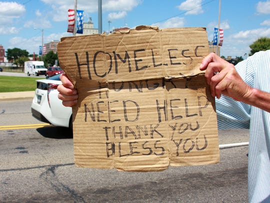 This file photo shows a panhandler seeking gifts of food.