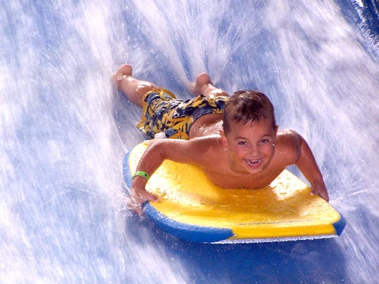 The thrill of boogie boarding on the FlowRider attraction