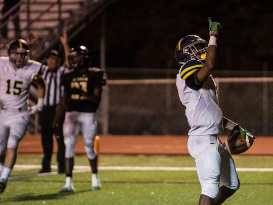 September 08, 2017 - Lausanne's Eric Gray celebrates after running in for a touchdown during Friday night's game at Whitehaven High School. Lausanne topped Whitehaven 14-7.