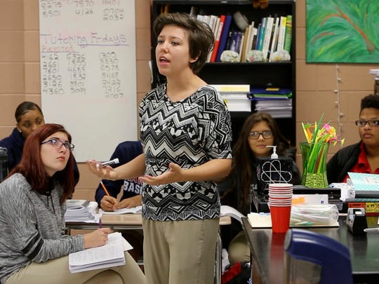In this file photo, Hancock High science teacher Elizabeth Hicks shares a lesson with her class in Kiln, Miss. As the state grapples with a teacher shortage, Hicks' skillset is in high demand—for school districts, science is one of the hardest subjects to staff.