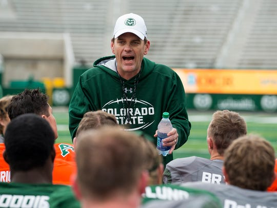 CSU football coach Mike Bobo talks to his team following