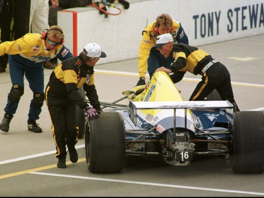Sam Schmidt, driving for Blueprint/Jacuzzi/Armour Golf/ERTL, is pushed after Parade Lap on the second day of the 81st running of the Indianapolis 500 Mile Race on May 26, 1997.